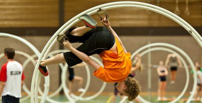 Boy Upside down using a German Wheel